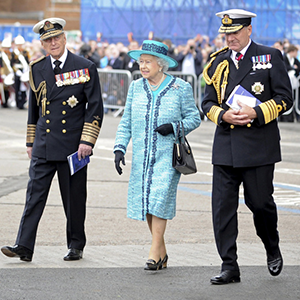 The Queen of England launches aircraft carrier with Whisky